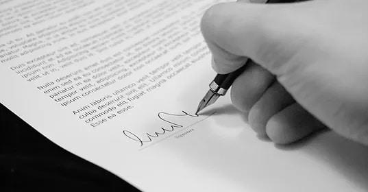 pen writing on document