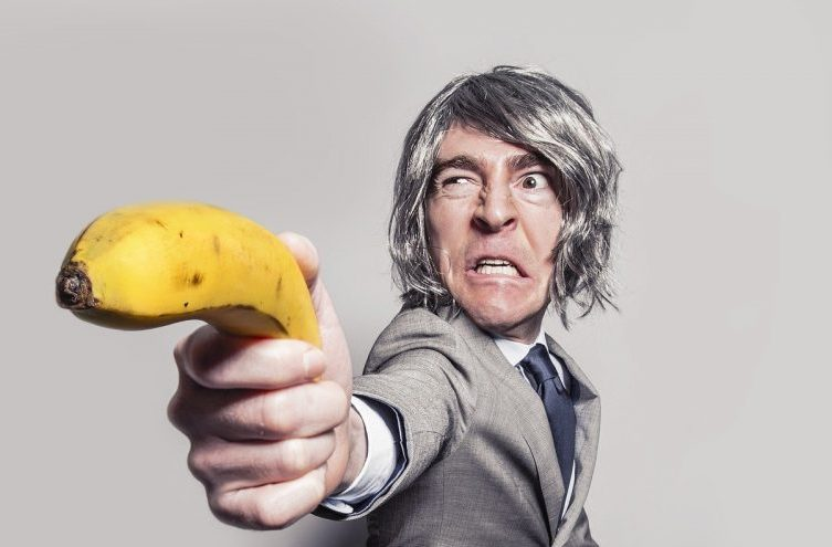 man in suit with banana